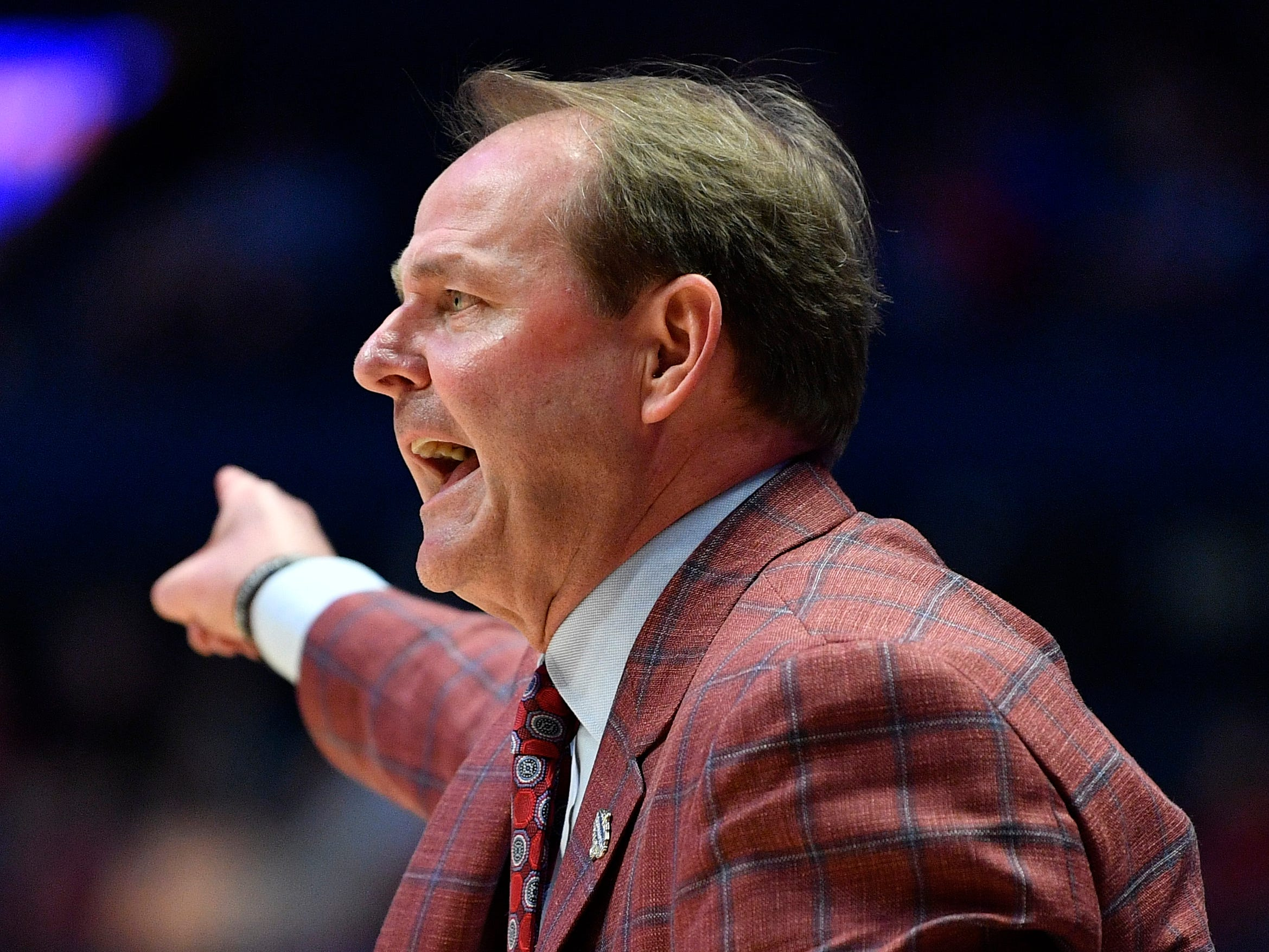 Ole Miss head coach Kermit Davis gestures to his team during the first half of the SEC Men's Basketball Tournament game at Bridgestone Arena in Nashville, Tenn., Thursday, March 14, 2019.