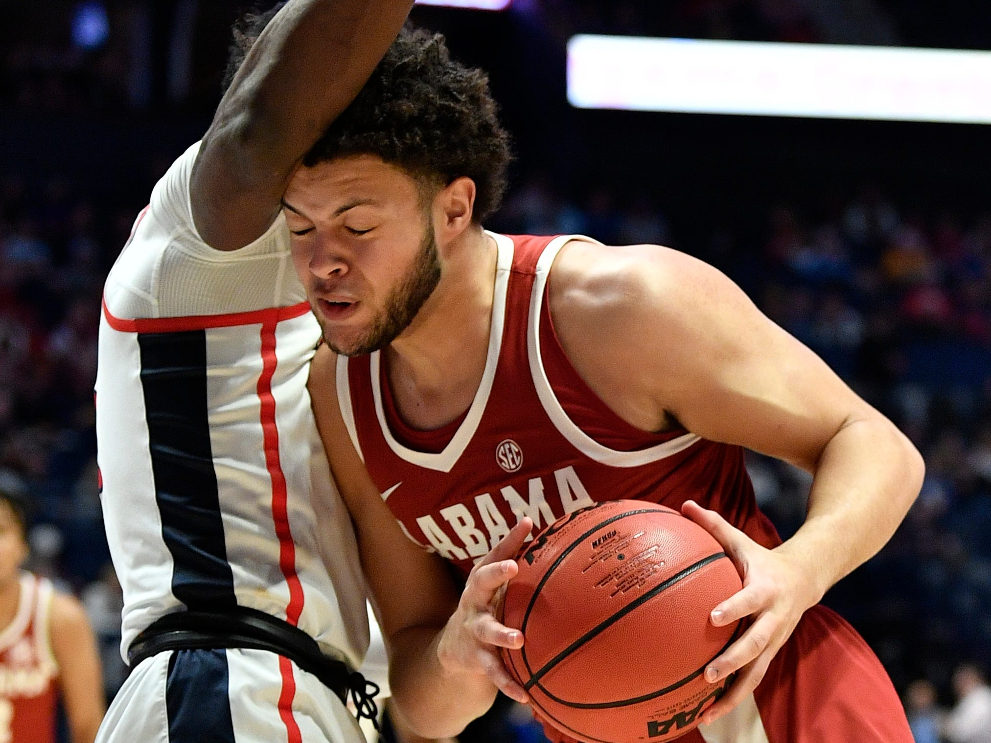 Alabama forward Alex Reese (3) tries to move the ball on Ole Miss guard Terence Davis (3) during the first half of the SEC Men's Basketball Tournament game at Bridgestone Arena in Nashville, Tenn., Thursday, March 14, 2019.