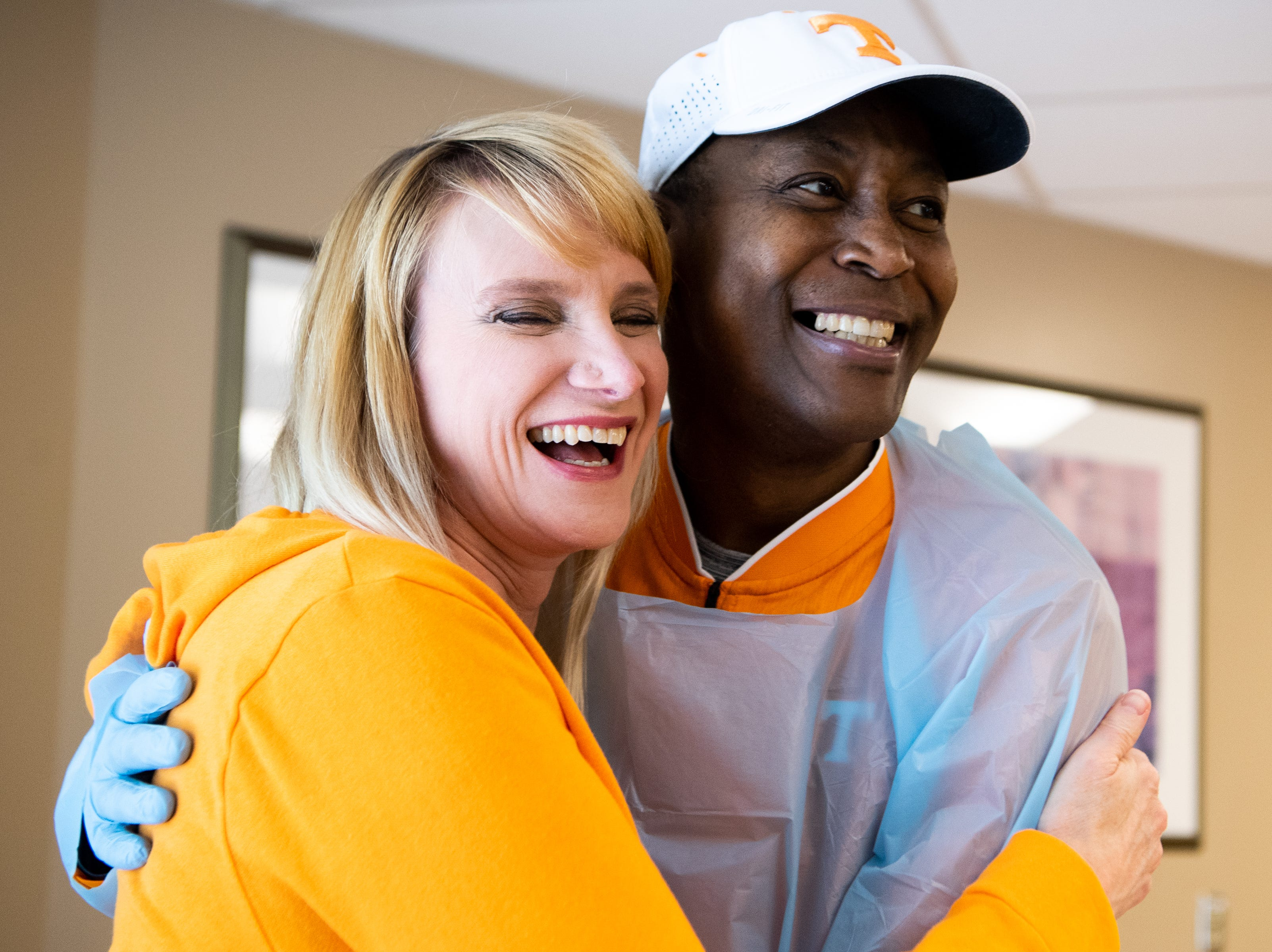 Former UT player Tony White, who is battling leukemia, hugs his wife Barbie White for a photo at Sarah Cannon Cancer Institute at TriStar Centennial on Thursday, March 14, 2019, in Nashville, Tenn.