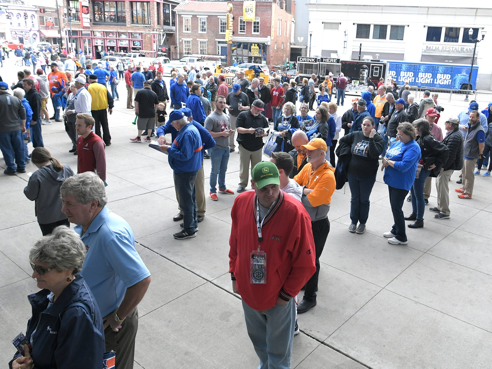 Fans line up to get into Bridgestone Arena for the SEC Men's Basketball Tournament in Nashville on Thursday, March 14, 2019.