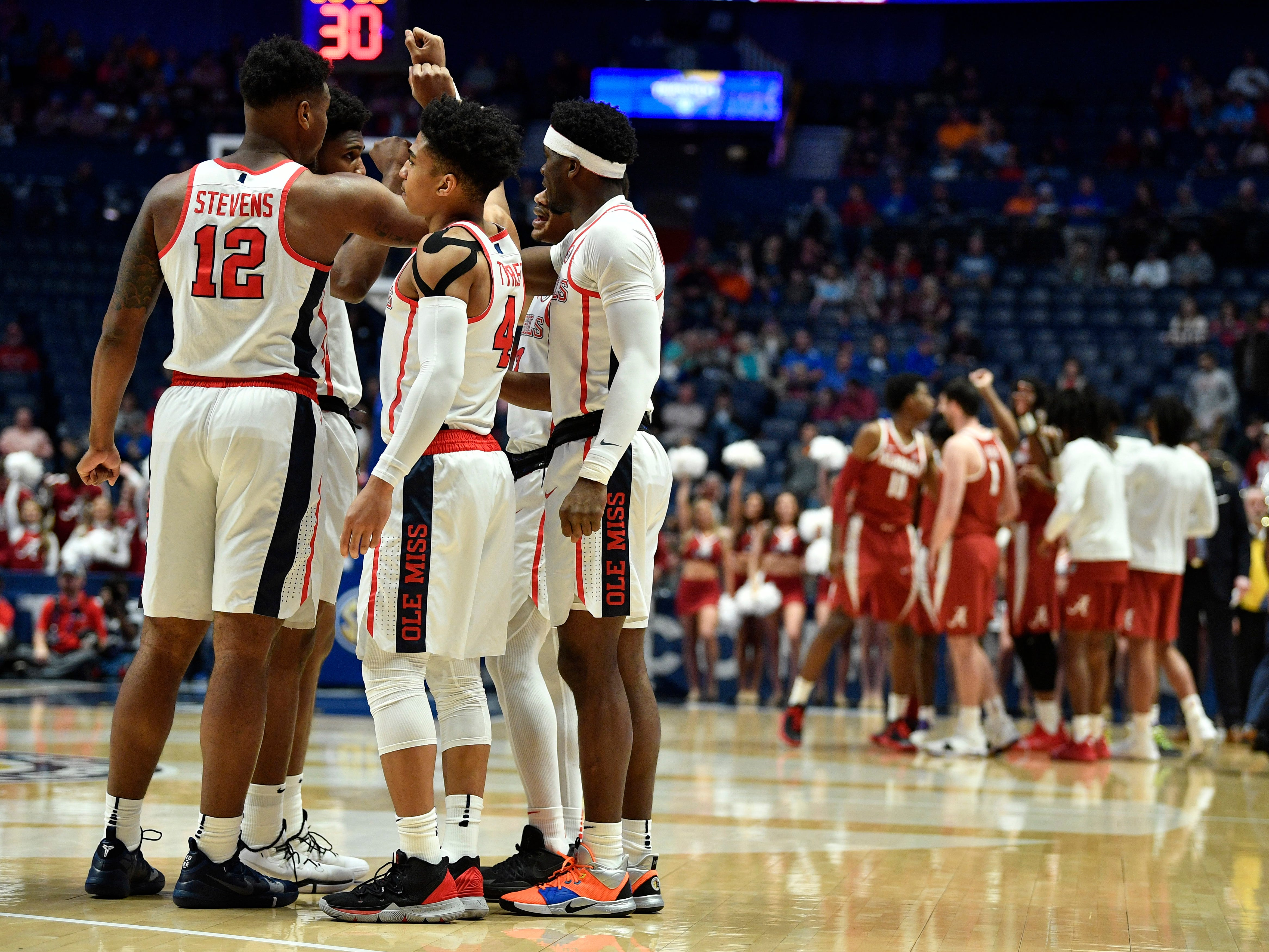 Ole Miss players huddle at the start of the SEC Men's Basketball Tournament game against Alabama at Bridgestone Arena in Nashville, Tenn., Thursday, March 14, 2019.