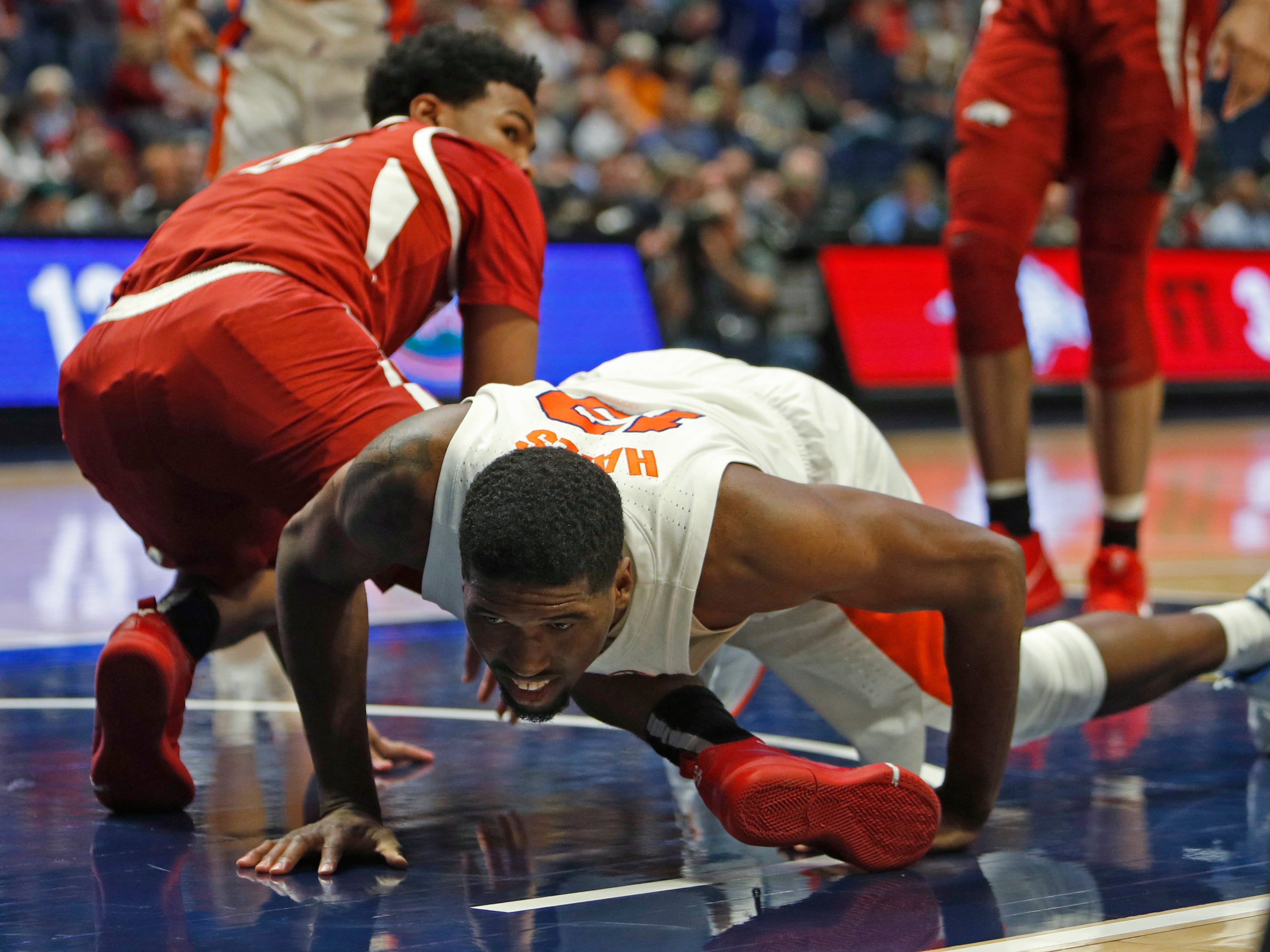 Florida center Kevarrius Hayes (13) looks up after colliding with an Arkansas player in the second half of the SEC Men's Basketball Tournament game at Bridgestone Arena in Nashville, Tenn., Thursday, March 14, 2019.