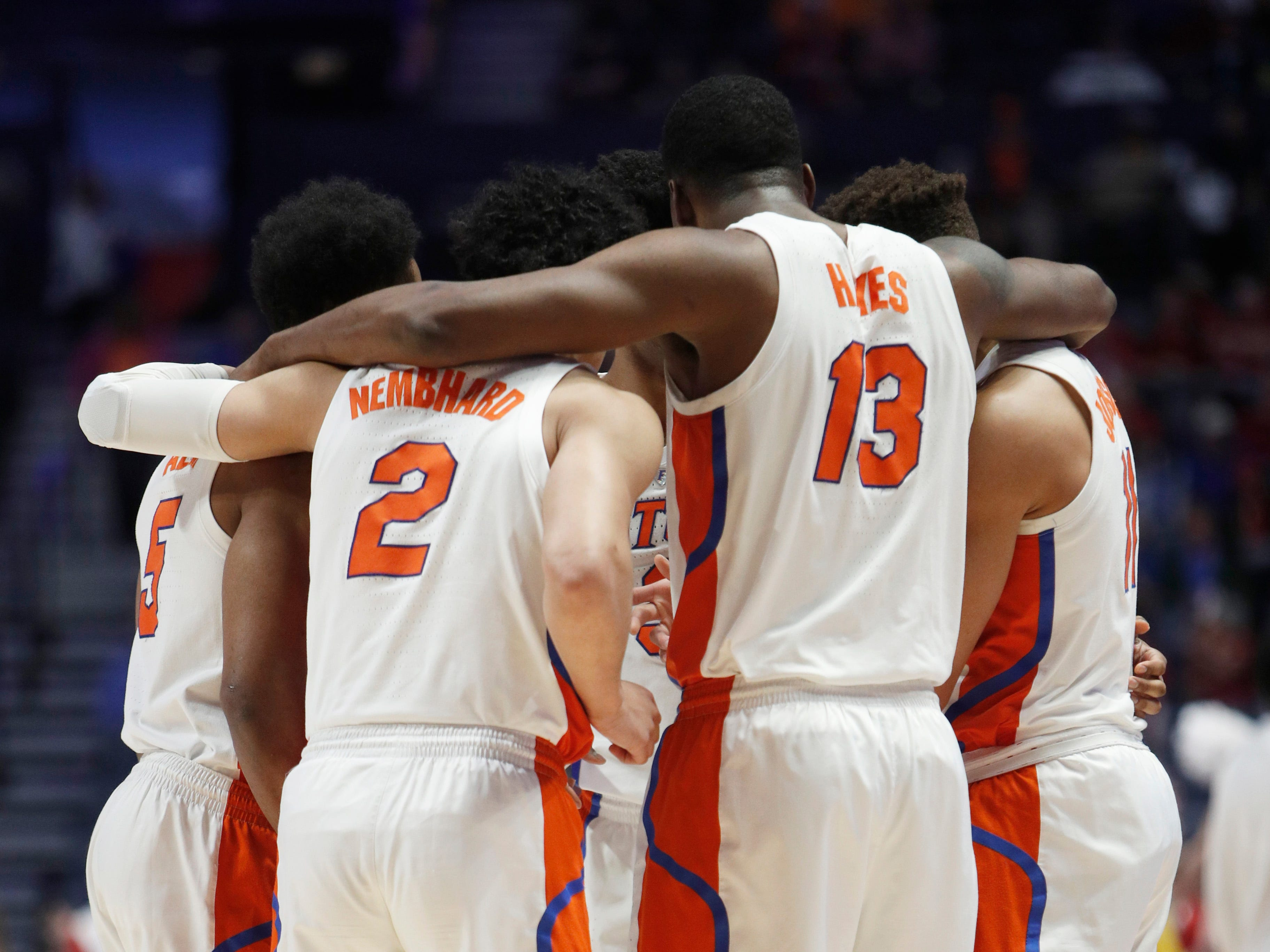 Florida players huddle at the start of the SEC Men's Basketball Tournament game at Bridgestone Arena in Nashville, Tenn., Thursday, March 14, 2019.
