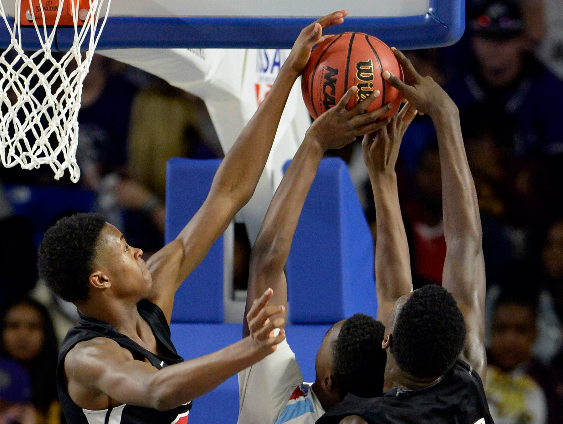 Pearl-Cohn guard Miquan Tucker, left, and forward Tyrone Marshall (24) block a shot by Brainerd forward Laderron Freeman (4) during the second half of an Class AA boys' state basketball quarterfinal game against Brainerd Wednesday, March 13, 2019, in Murfreesboro, Tenn. Brainerd won 76-73.