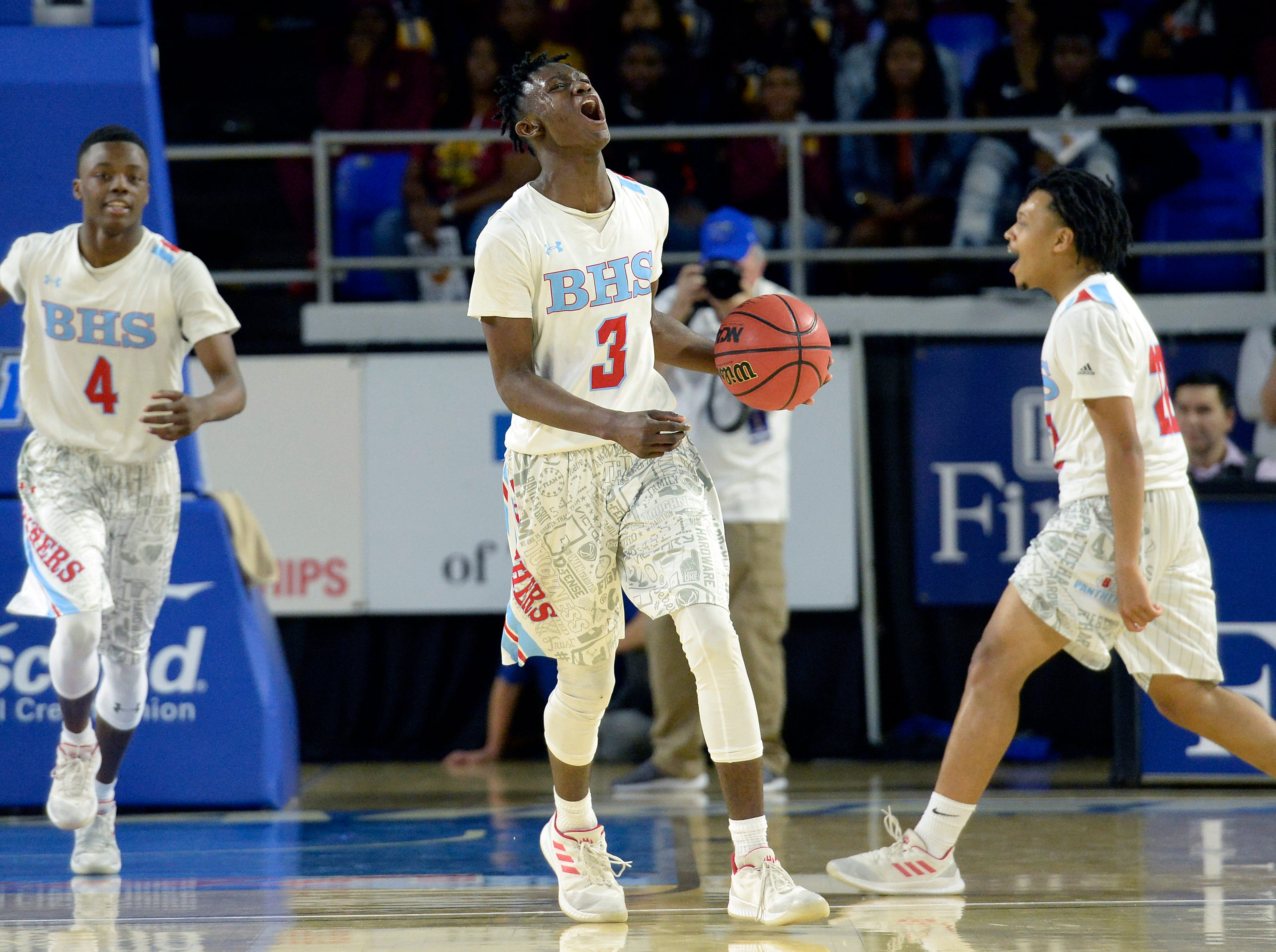 Brainerd's Laderron Freeman (4), Tommie Owten (3) and Cavonte McKibbens, right, celebrate after the team's 76-73 win against Pearl-Cohn in a Class AA boys state basketball quarterfinal game Wednesday, March 13, 2019, in Murfreesboro, Tenn.