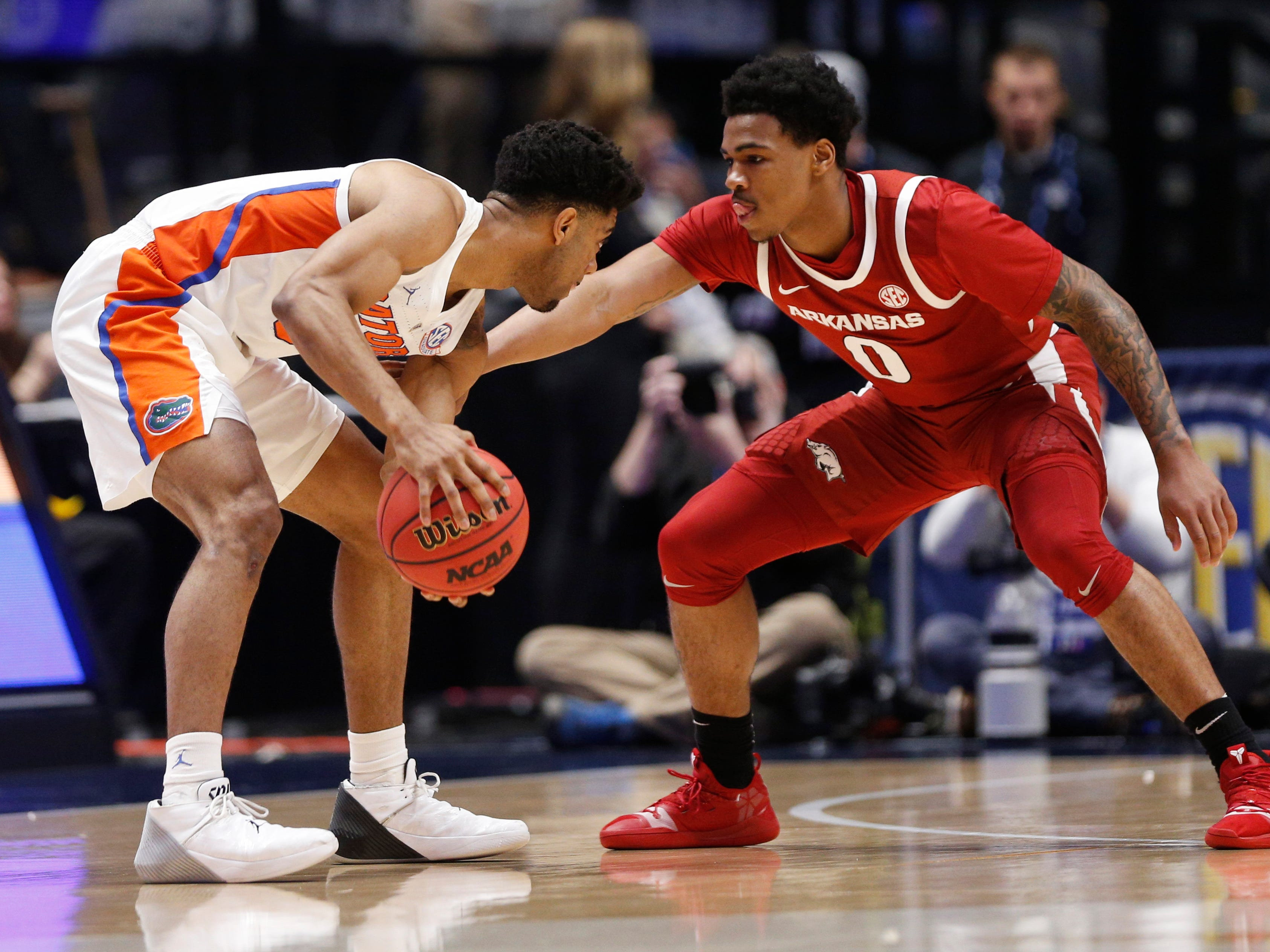 Florida guard Jalen Hudson (3) moves the ball defended by Arkansas guard Desi Sills (0) during the first half of the SEC Men's Basketball Tournament game at Bridgestone Arena in Nashville, Tenn., Thursday, March 14, 2019.