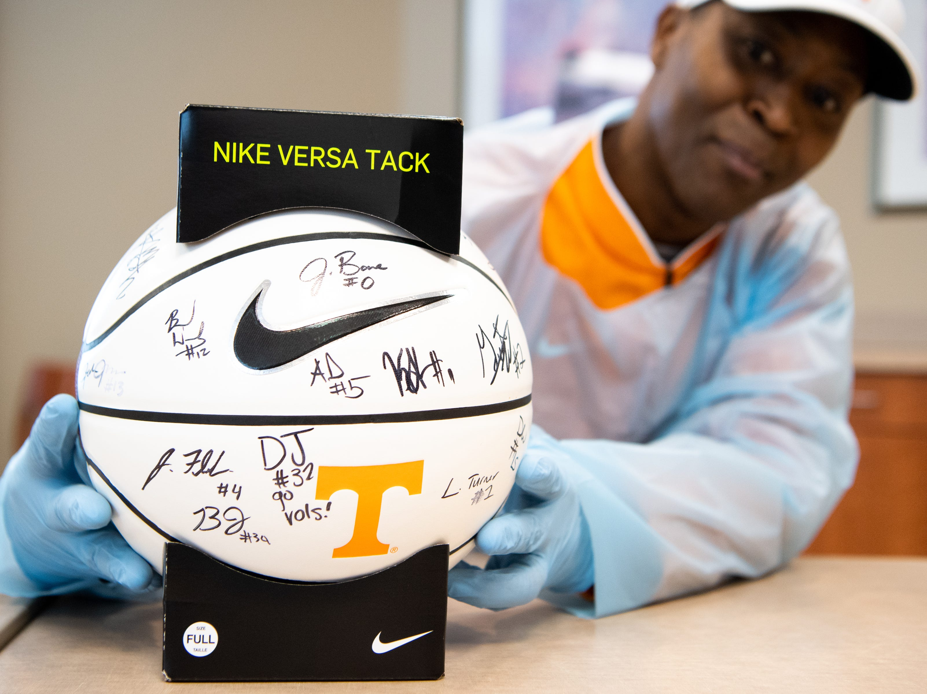 Former UT player Tony White, who is battling leukemia, grabs the basketball which was signed by the Tennessee Volunteers men's basketball team at Sarah Cannon Cancer Institute at TriStar Centennial on Thursday, March 14, 2019, in Nashville, Tenn.