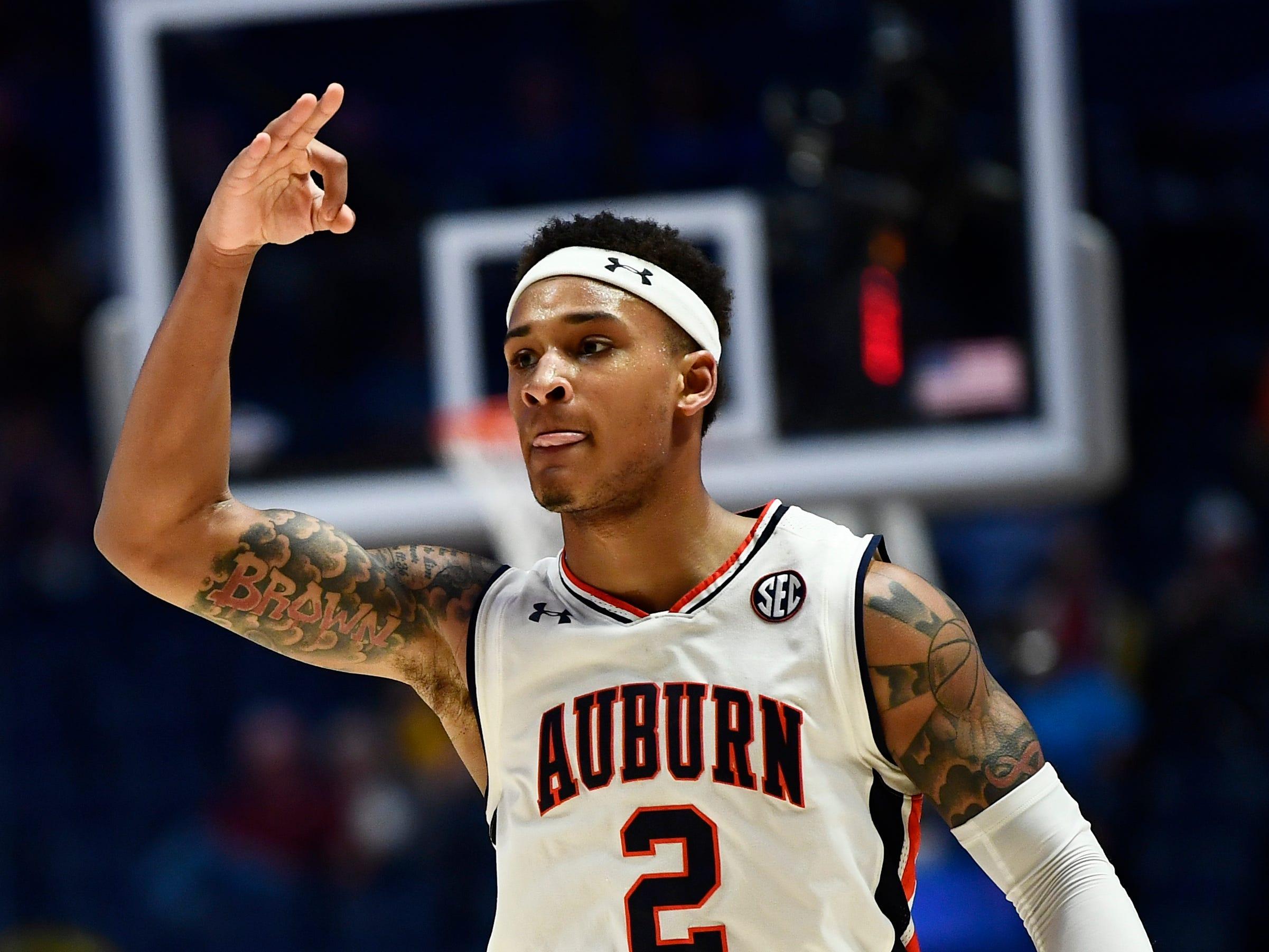 Auburn guard Bryce Brown (2) celebrates a three-pointer during the second half of the SEC Men's Basketball Tournament game at Bridgestone Arena in Nashville, Tenn., Thursday, March 14, 2019.