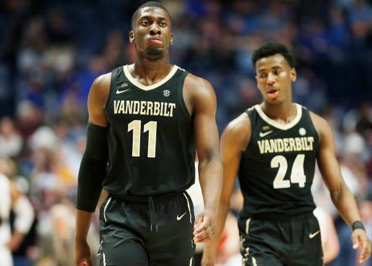Vanderbilt forward/center Simisola Shittu (11) and forward Aaron Nesmith (24) react during the first half of the SEC Men's Basketball Tournament game at Bridgestone Arena in Nashville, Tenn., Wednesday, March 13, 2019.