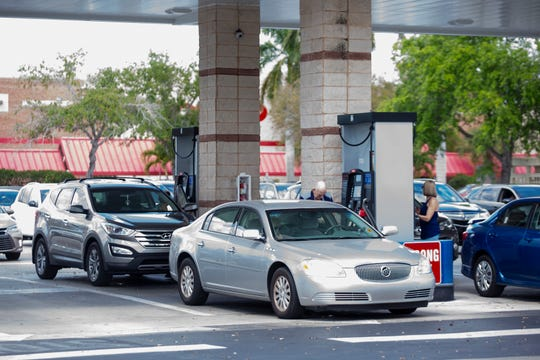 Cars line up for gas, Thursday, March 14, 2019, at Costco at 6275 Naples Boulevard.