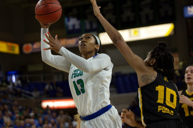 Florida Gulf Coast University's Kerstie Phills goes for a layup against Kennesaw State, Wednesday, March 13, 2019, at Florida Gulf Coast University's Alico Arena.