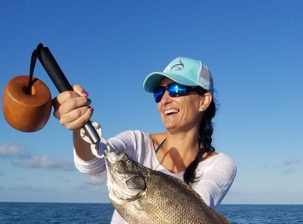 Ashlynn T with a nice catch-and-release tripletail.