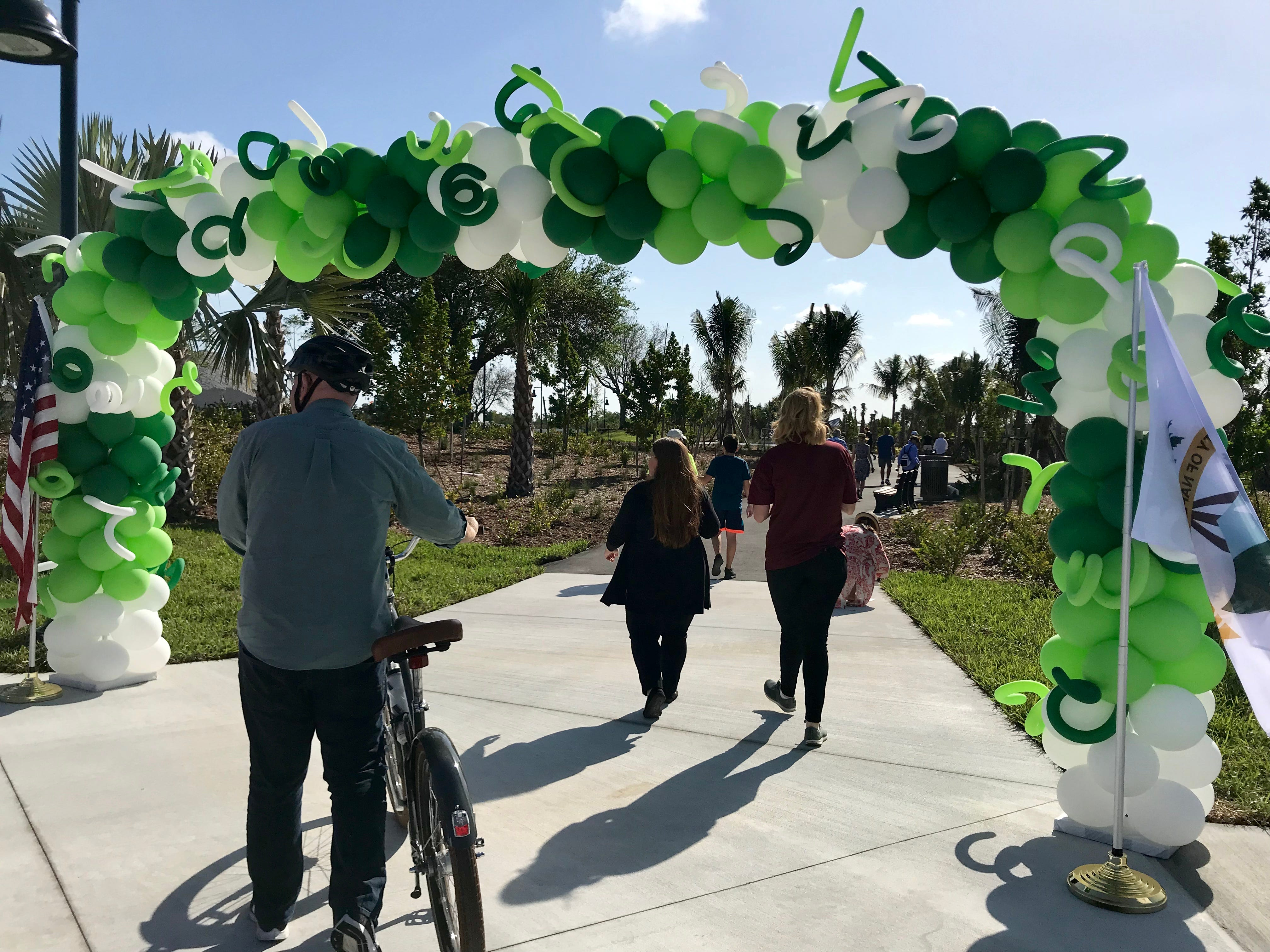 Community members explore Baker Park after the dedication ceremony on March 14, 2019. The first portion of Baker Park opened on March 14. The rest of the park is set to open in October.