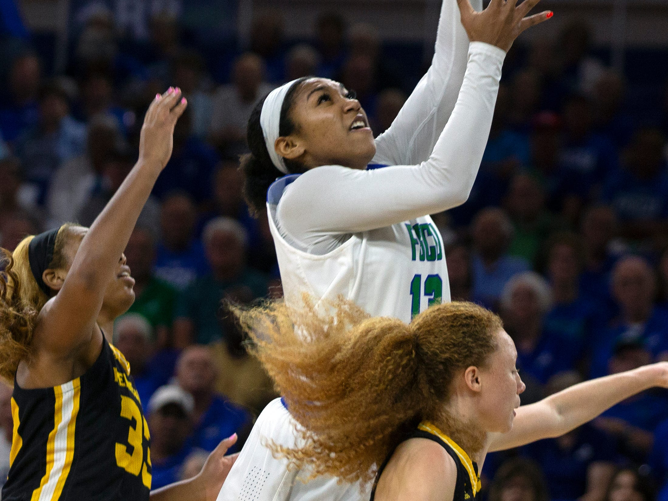 Florida Gulf Coast University's Kerstie Phills goes up for a layup against Kennesaw State, Wednesday, March 13, 2019, at Florida Gulf Coast University's Alico Arena.