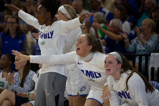 Florida Gulf Coast University bench celebrate a basket against Kennesaw State on Wednesday at Alico Arena.