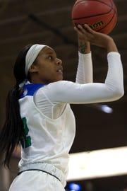 Florida Gulf Coast University's Destiny Washington shoots the ball against Kennesaw State on Wednesday at  Alico Arena.
