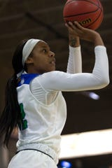 Florida Gulf Coast University's Destiny Washington shoots the ball against Kennesaw State on Wednesday at  Alico Arena.
