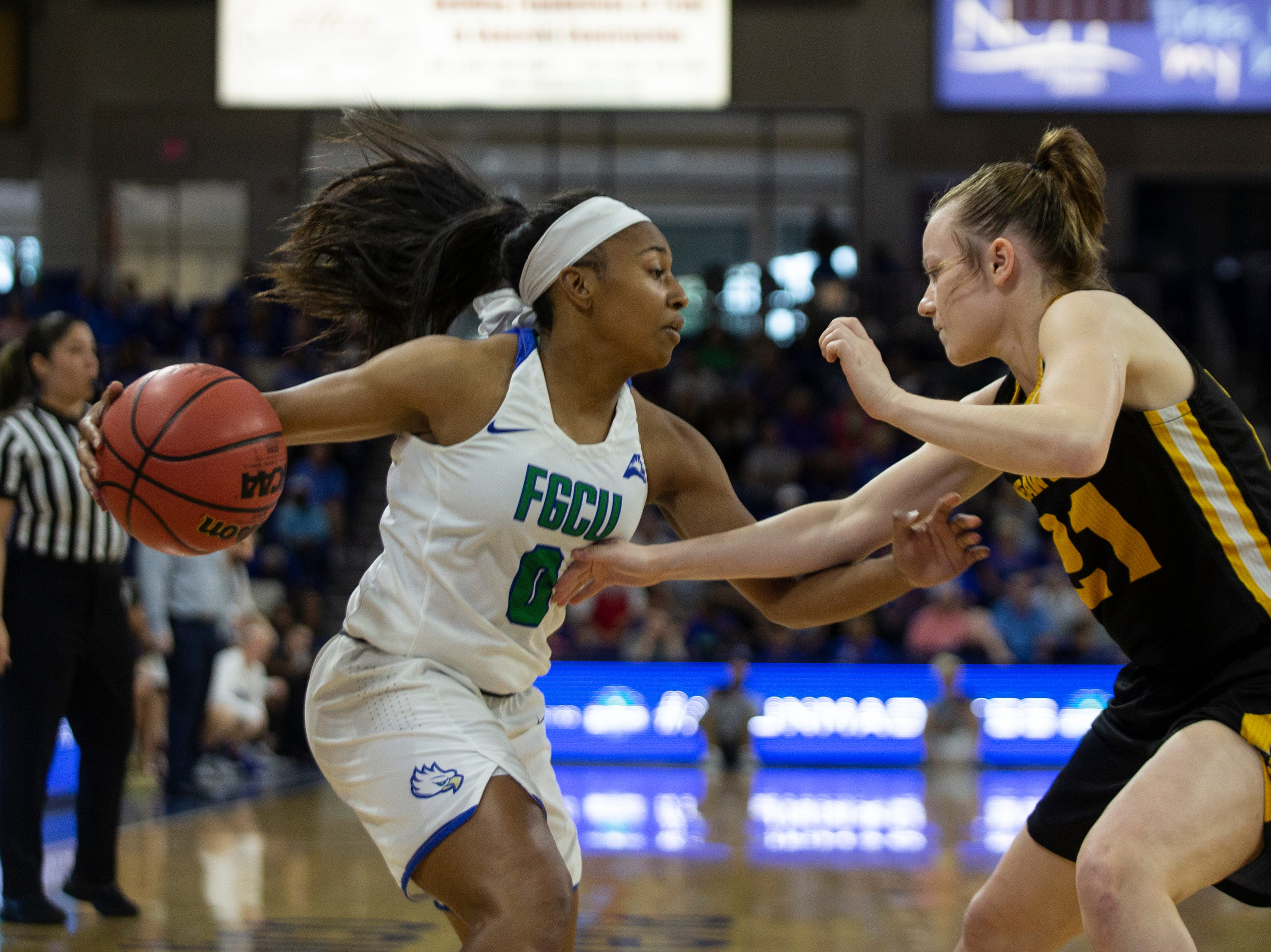 Florida Gulf Coast University'sDavion Wingate dribbles the ball against game against Kennesaw State'sBreanna Hoover during their game on Wednesday, March 13, 2019, at Florida Gulf Coast University's Alico Arena.