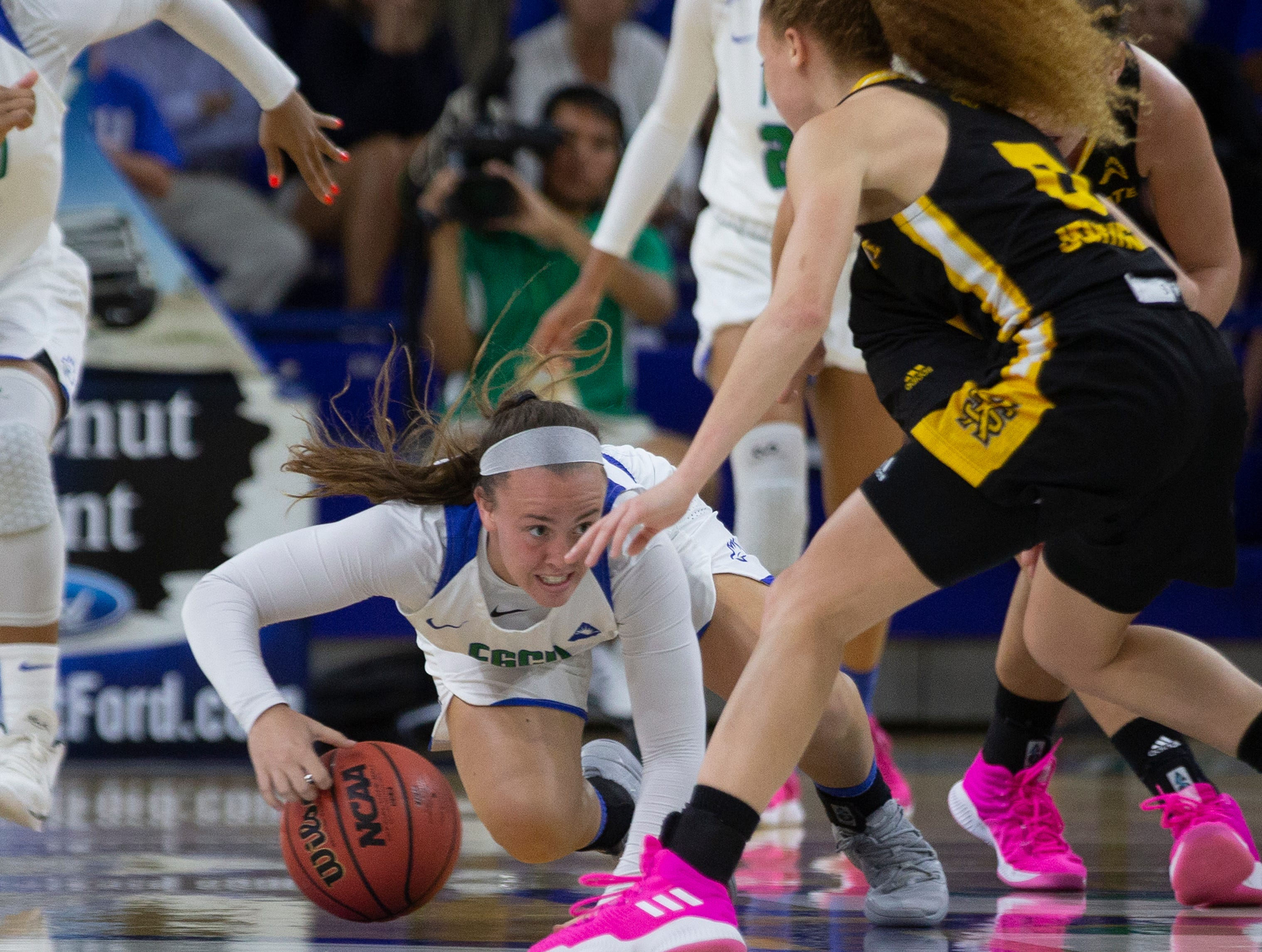 Florida Gulf Coast University's Chandler Ryan dives for the lose ball during their game against Kennesaw State, Wednesday, March 13, 2019, at Florida Gulf Coast University's Alico Arena.