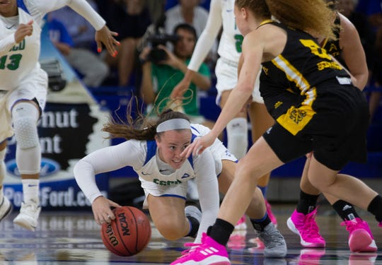 Florida Gulf Coast University's Chandler Ryan dives for the lose ball during their game against Kennesaw State on Wednesday at Alico Arena.