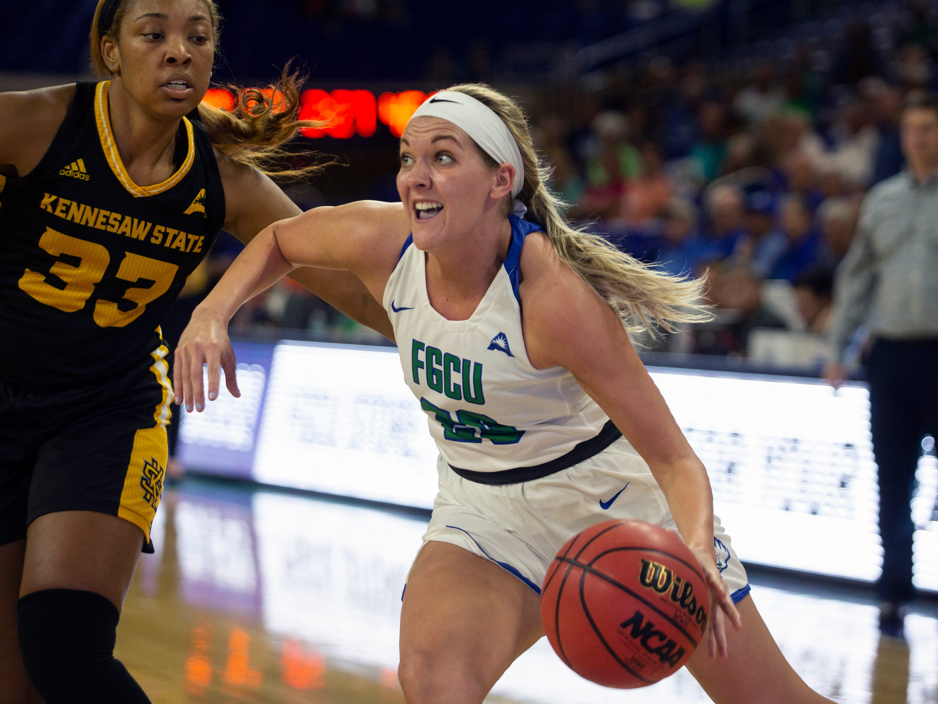 Florida Gulf Coast University's Tanner Bryant dribbles the ball while defended by Kennesaw State's Lexi Mann, Wednesday, March 13, 2019, at Florida Gulf Coast University's Alico Arena.