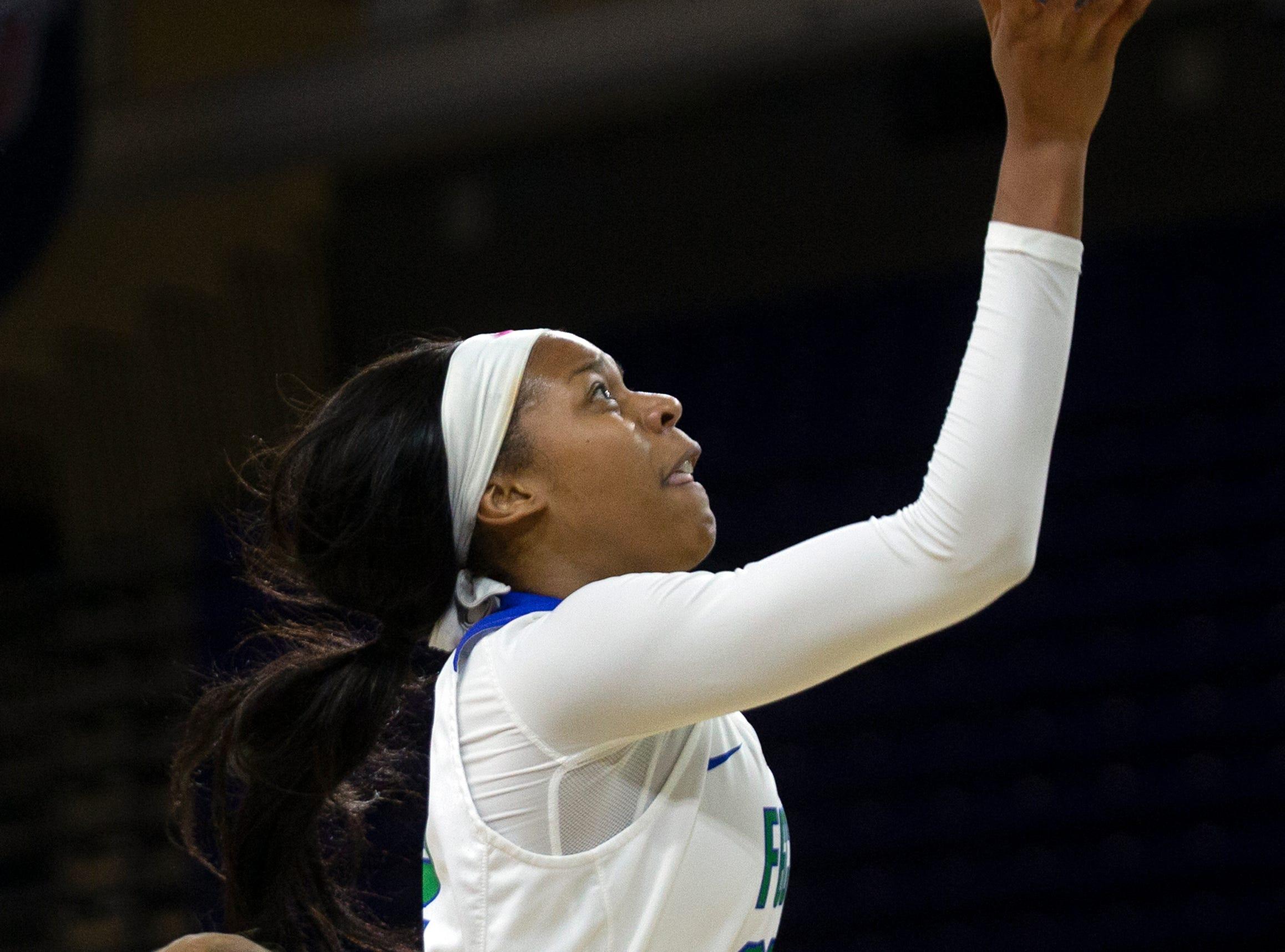 Florida Gulf Coast University's Destiny Washington goes for a layup against Kennesaw State, Wednesday, March 13, 2019, at Florida Gulf Coast University's Alico Arena.
