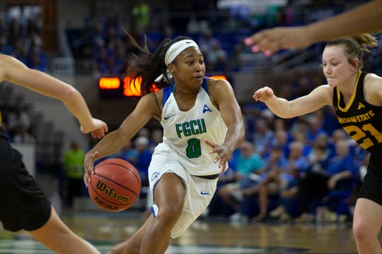 Florida Gulf Coast University's Davion Wingate drives to against Kennesaw State on Wednesday at Alico Arena.