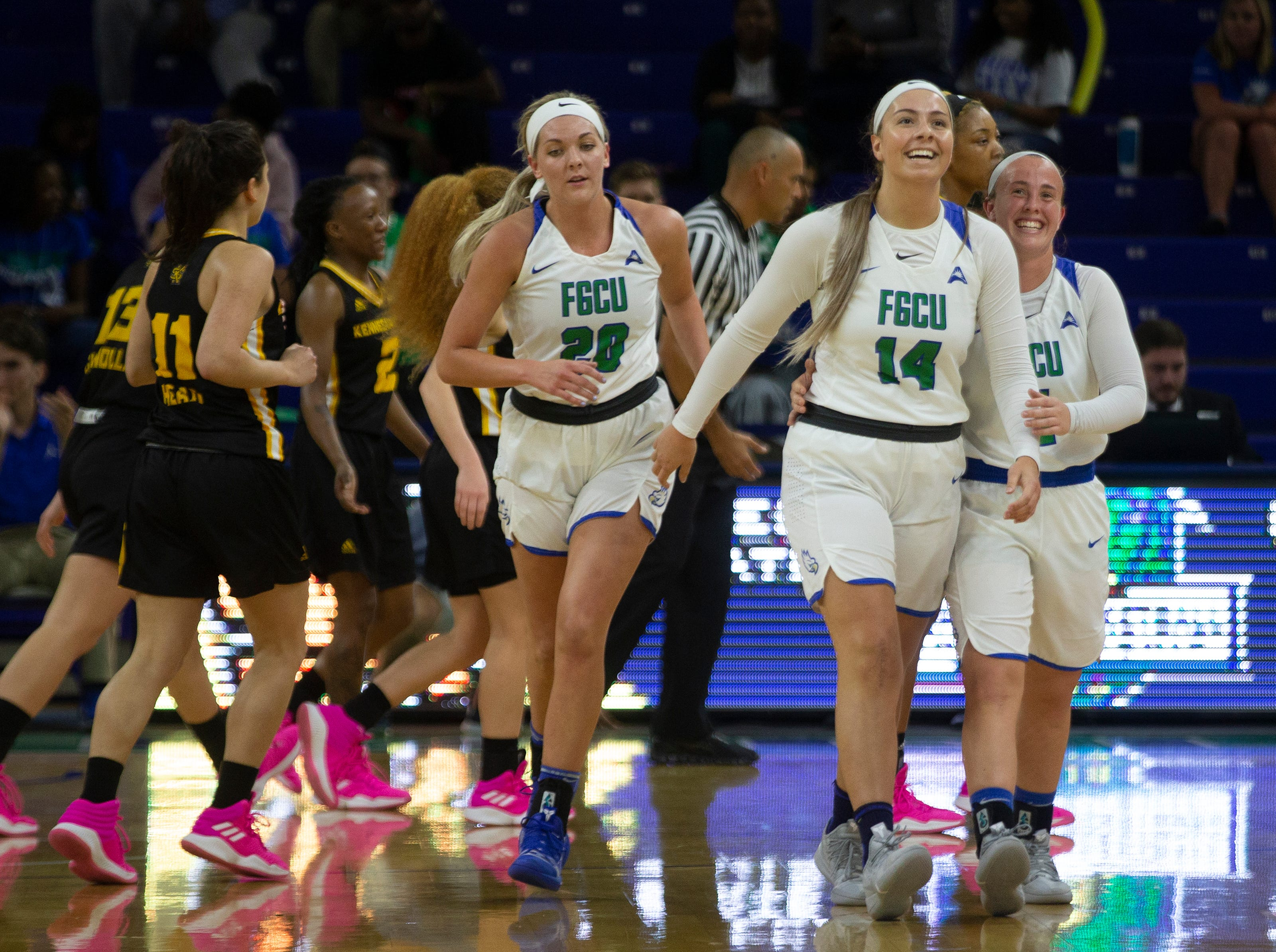 Florida Gulf Coast University's Tanner Bryant, Brittany Johnson and Chandler Ryan walk off the court after defeating Kennesaw State 48-77 on Wednesday, March 13, 2019, at Florida Gulf Coast University's Alico Arena.
