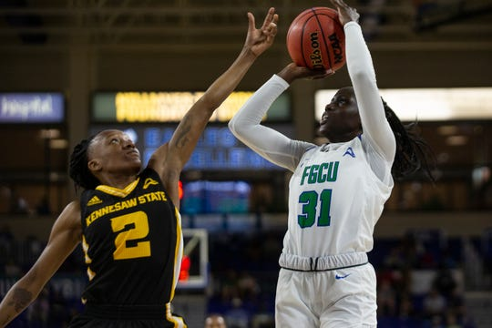 Florida Gulf Coast University's Nasrin Ulel attempts a shot over Kennesaw State's Kamiyah Street, Wednesday, March 13, 2019, at Florida Gulf Coast University's Alico Arena.