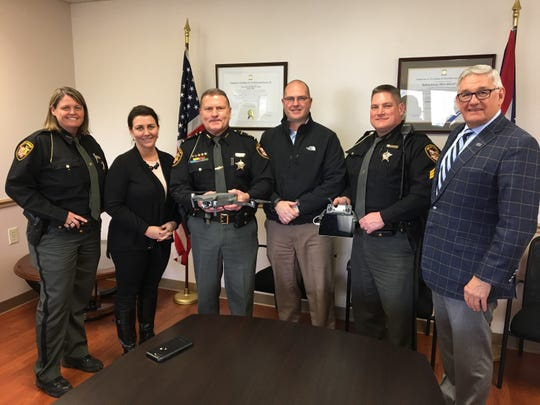 Members of the Licking County Sheriff's Office and Park National Bank pose for a picture during a drone flight celebration on Monday, March 11, 2019.