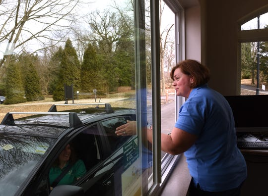 Dawes Arboretum guest services manager Kelley McCormack helps director of development Leigh Ann Miller practice the new entrance procedure for the arboretum. Starting April 15, 2019 entrance fees will be $10 for adults (15-years-old and older), $5 for children 5-15 years-old, and free for children 5 and under. Annual memberships are $60 for a family and $40 for an adult and a guest. Visitors with a Supplemental Nutrition Assistance ProgramÊcard will be admitted forÊ$3 per person.