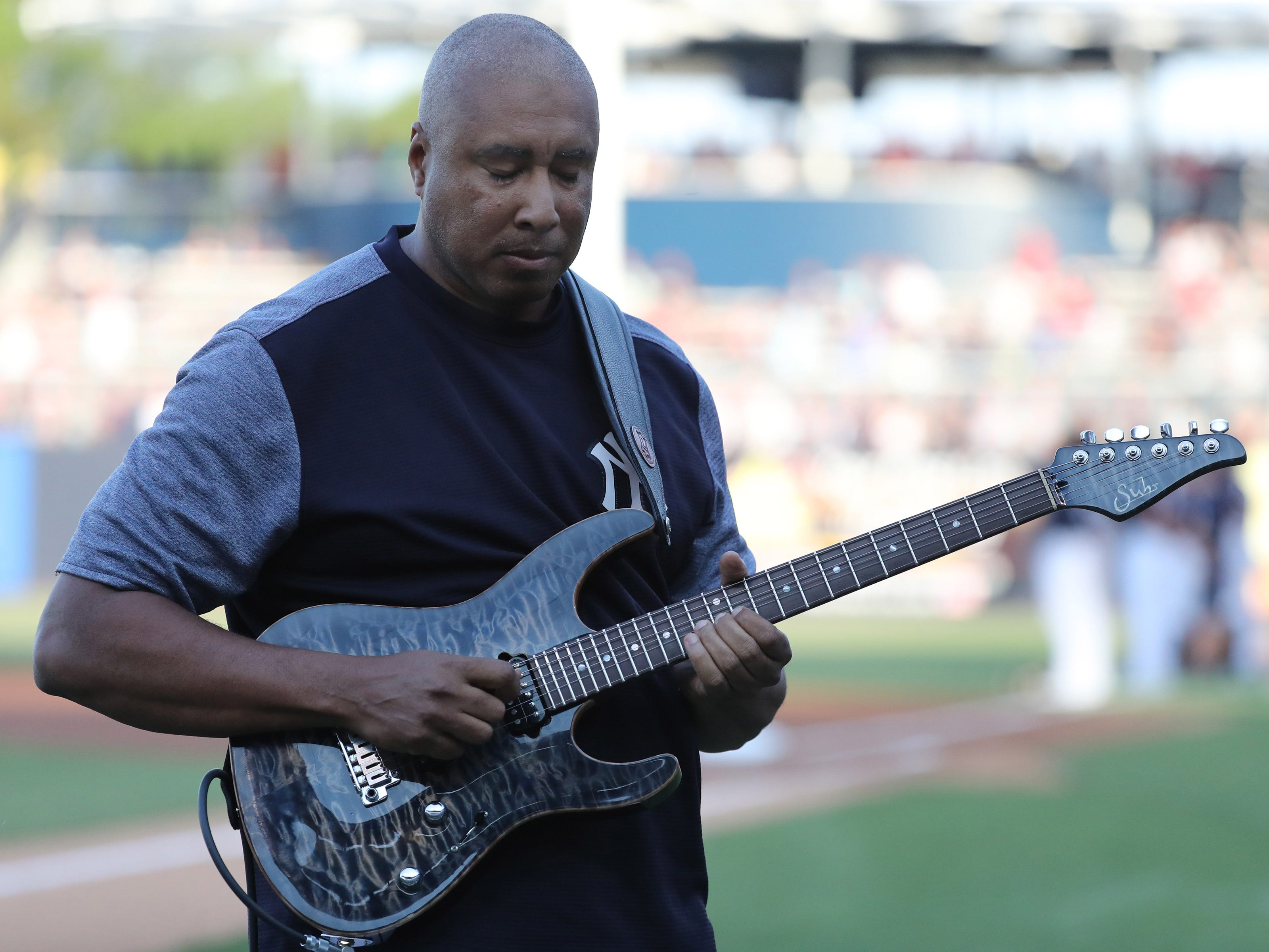 Mar 13, 2019; Tampa, FL, USA; New York Yankees former player Bernie Williams plays the national anthem on his guitar prior to the game between the New York Yankees and Philadelphia Phillies at George M. Steinbrenner Field.