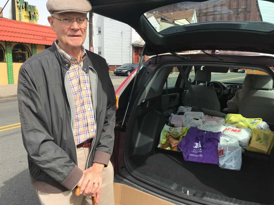 Mahwah resident Arthur Collard near the end of his book delivery to the Boys and Girls Club of Paterson and Passaic.