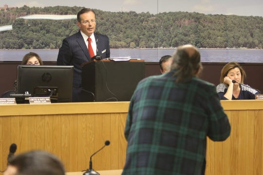 Englewood Cliffs Mayor Mario Kranjac argues with town resident Tony Morfesis during the public statement portion of a town meeting on March 14, 2019.