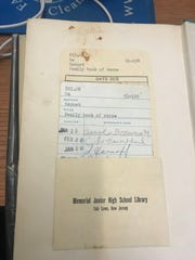 """The library card from """"The Family Book of Verse"""" is so old that it displays the Fair Lawn's school old name, Memorial Junior High School"""