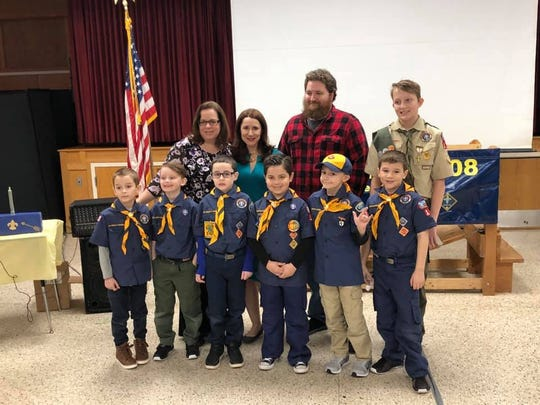 Justin Van de Voort, second from right in back row, was invited by Caleb's former Cub Scout pack to its recent Blue and Gold Dinner to accept the Spirit of the Eagle Award on behalf of his son.