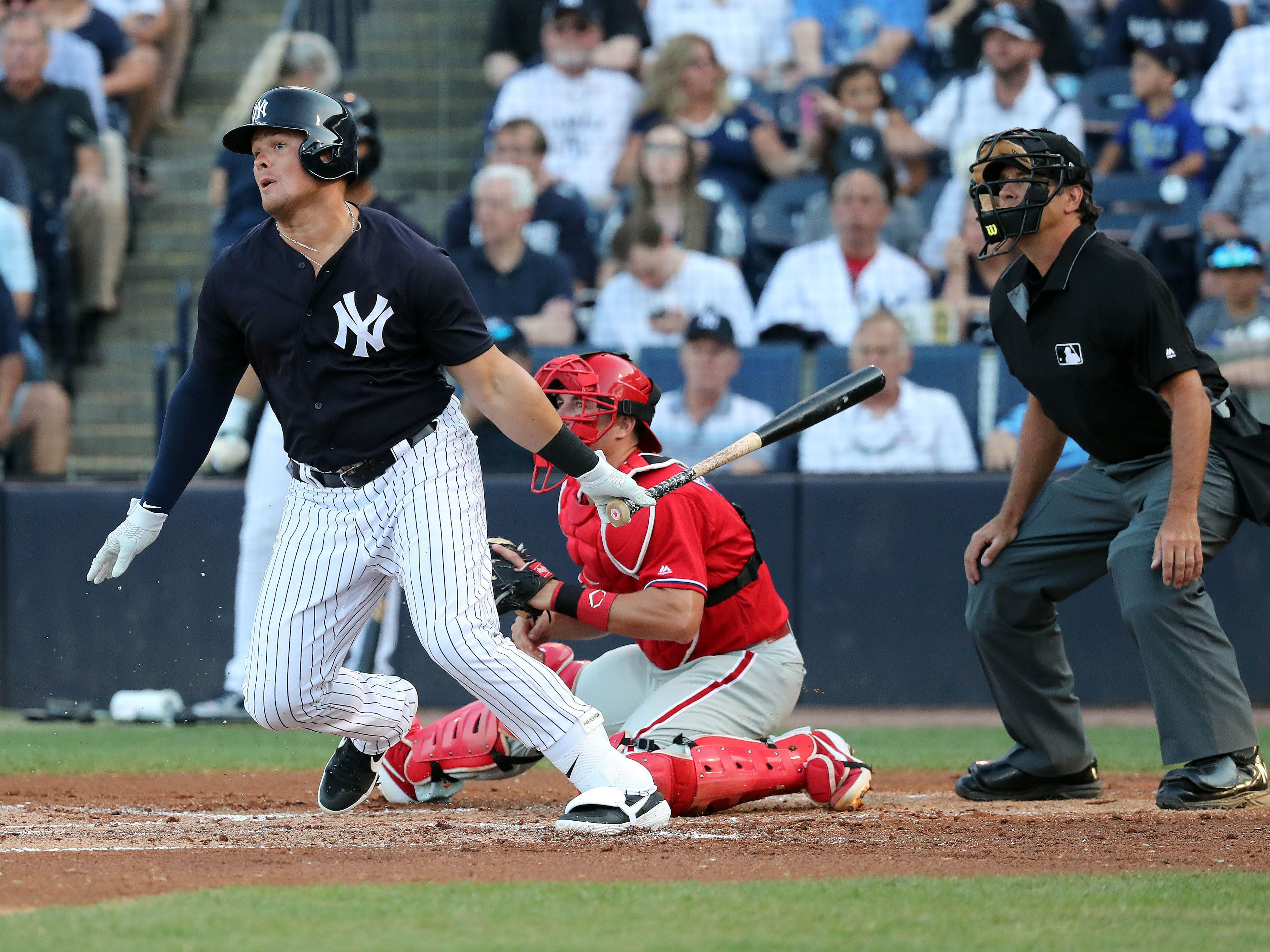 Mar 13, 2019; Tampa, FL, USA; New York Yankees first baseman Luke Voit (45) hits a RBI single during the first inning against the Philadelphia Phillies at George M. Steinbrenner Field.