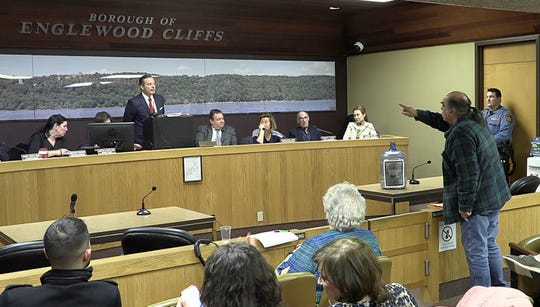 Englewood Cliffs Mayor Mario Kranjac argues with a town resident during the public statement portion of a town meeting on March 14, 2019.