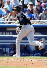 Mar 14, 2019; Dunedin, FL, USA; New York Yankees shortstop Troy Tulowitzki (12) singles during the fourth inning against the Toronto Blue Jays at Dunedin Stadium.