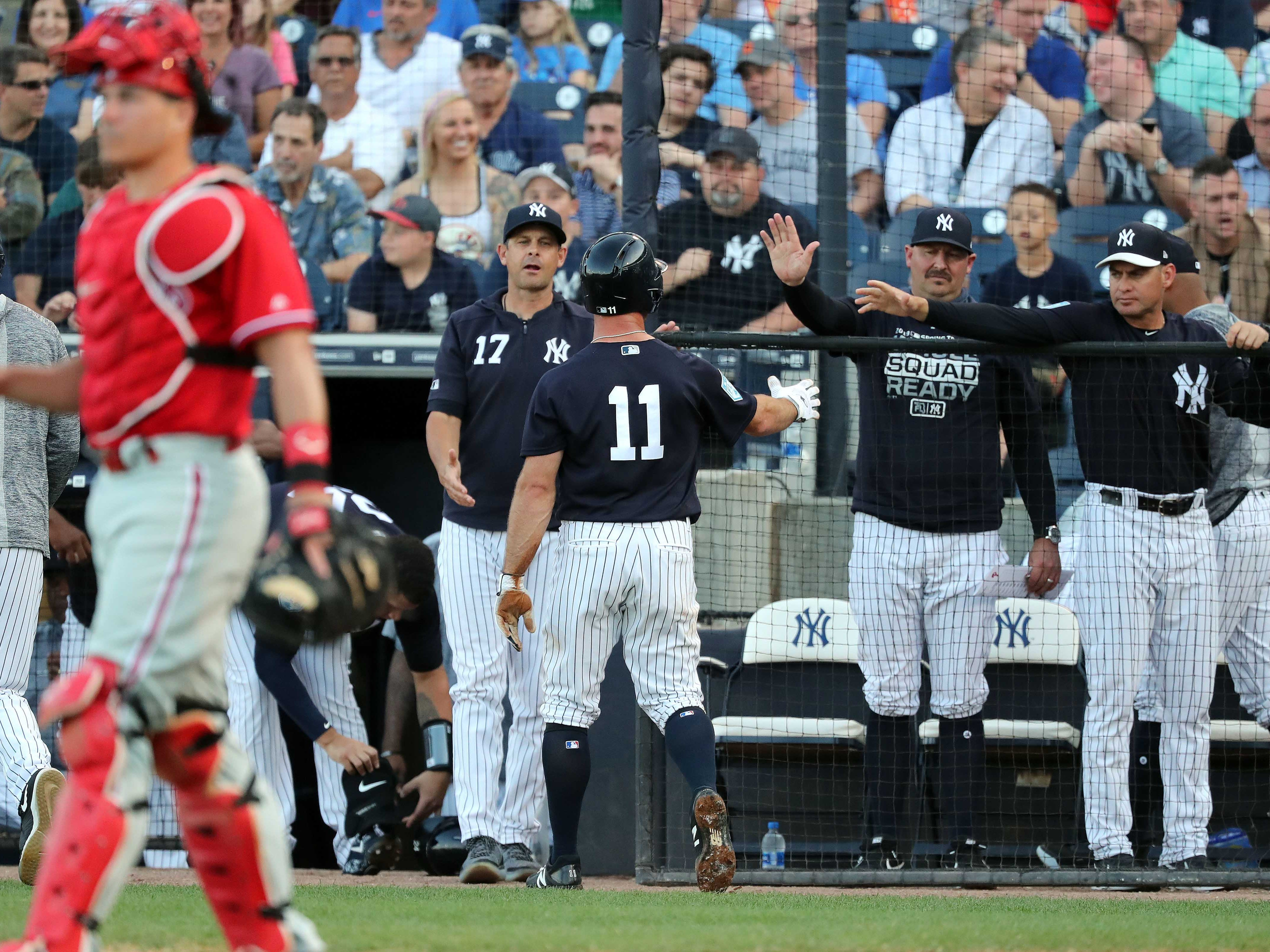 Mar 13, 2019; Tampa, FL, USA;New York Yankees center fielder Brett Gardner (11) celebrates after scoring a run during the first inning against the Philadelphia Phillies at George M. Steinbrenner Field.