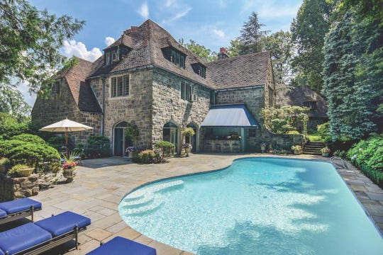 The outdoor pool and patio in the Montclair estate of bestselling author Dorothea Benton Frank