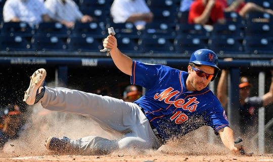 Mar 4, 2019; West Palm Beach, FL, USA; New York Mets designated hitter Travis d'Arnaud (18) scores a run on a double by first baseman Peter Alonso (20, not pictured) in the fourth inning against the Houston Astros during the spring training game at FITTEAM Ballpark of the Palm Beaches.