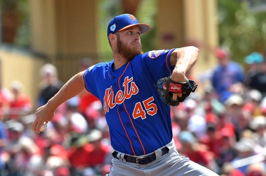 Mar 14, 2019; Jupiter, FL, USA; New York Mets starting pitcher Zack Wheeler (45) throws against the St. Louis Cardinals during a spring training game at Roger Dean Chevrolet Stadium.