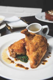 The pan-roasted chicken -- pepper oil, swiss chard, chicken jus -- at The Fox and the Falcon, a restaurant on Valley St. in South Orange.