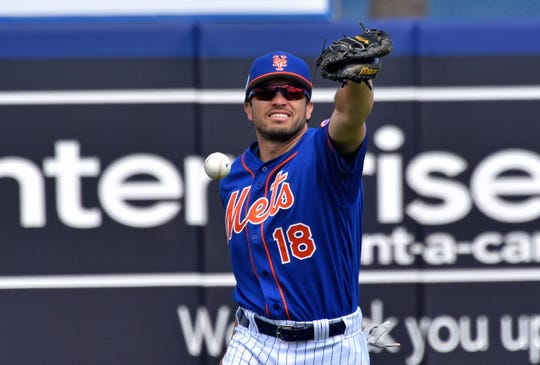 Mar 8, 2019; Port St. Lucie, FL, USA; New York Mets catcher Travis d'Arnaud (18) is unable to make a catch prior to a spring training game against the Miami Marlins at First Data Field.
