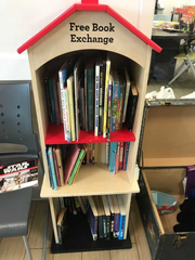 Books-for-the-taking greet members in the front lounge of the Boys and Girls Club in Paterson.