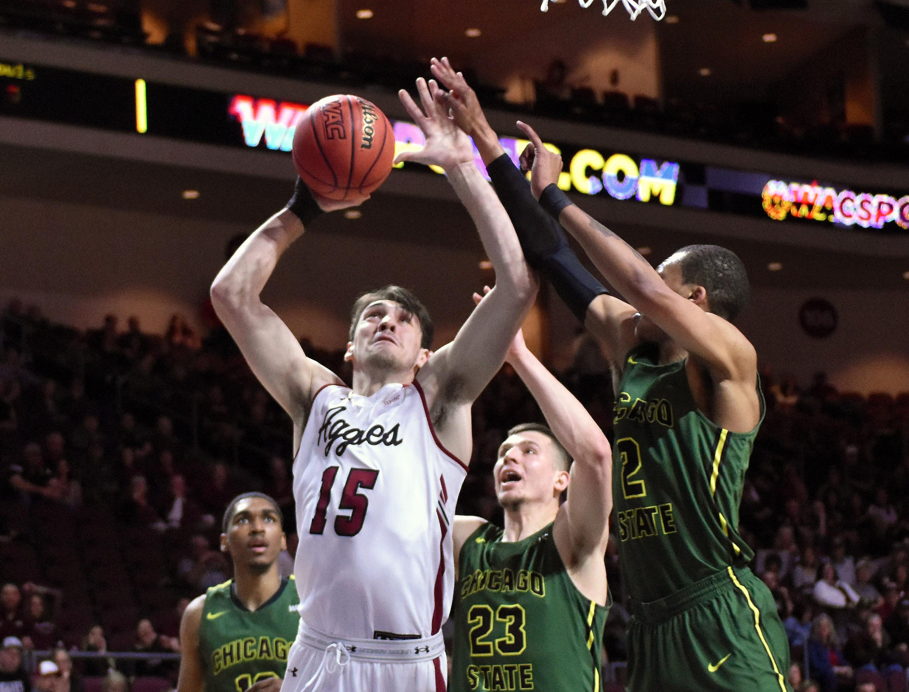 New Mexico State's Ivan Aurrecoechea muscles in a layup against the Chicago State defense in the first half a WAC Tournament first-round game Thursday, March 14, 2019, at the Orleans Arena in Las Vegas, Nevada.
