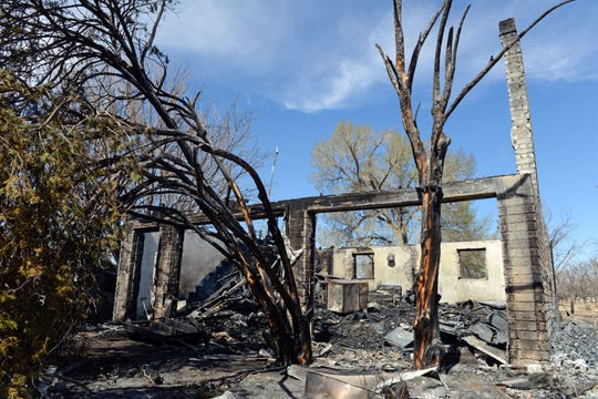 Remains of a house in Hatch where 27-year-old Maddy Franzoy rescued her 80-year-old cousin Johnny Franzoy from a fire on Sunday, March 3, 2019.