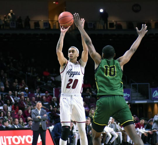 New Mexico State's Trevelin Queen shoots over Chicago State's Anthony Harris in the first half a WAC Tournament first-round game Thursday, March 14, 2019, at the Orleans Arena in Las Vegas, Nevada.