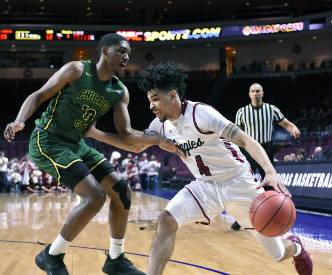 New Mexico State's JoJo Zamora drives the baseline against Chicago State's Anthony Harris in the first half a WAC Tournament first-round game Thursday, March 14, 2019, at the Orleans Arena in Las Vegas, Nevada.